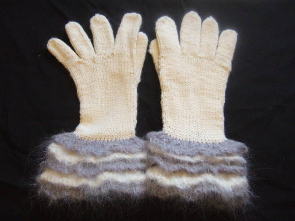 a pair of ruffled edged gloves