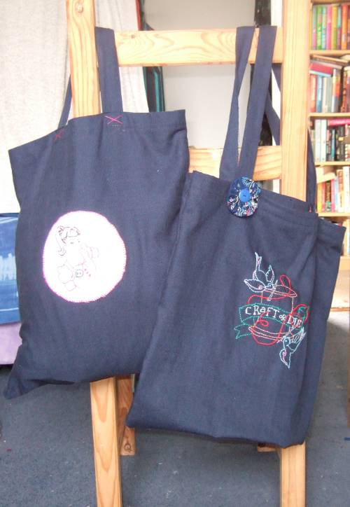 A pair of tote bags